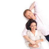 A young and happy Caucasian couple laying together Royalty Free Stock Image
