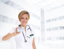 A young and happy Caucasian female doctor Royalty Free Stock Photography