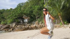 Young Happy Caucasian Girl Swinging on a Swing on the Beach. HD Slowmotion. Koh Phangan, Thailand. stock footage