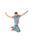 Young happy caucasian man jumping in the air Stock Photos