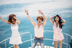 Young happy caucasian people dancing in boat party royalty free stock photo