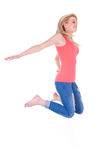 Young happy caucasian teenage girl jumping - Caucasian people Royalty Free Stock Image