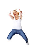 Young happy caucasian woman jumping in the air Royalty Free Stock Photo