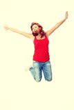 Young happy caucasian woman jumping in the air Royalty Free Stock Images