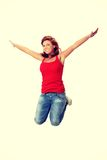 Young happy caucasian woman jumping in the air Stock Photography
