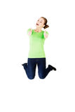 Young happy caucasian woman jumping in the air with thumbs up Royalty Free Stock Photo