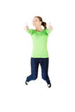 Young happy caucasian woman jumping in the air with thumbs up Royalty Free Stock Images