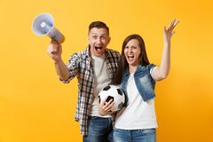 Young happy cheerful couple supporter, woman man, football fans cheer up support team, holding megaphone, soccer ball. Young happy cheerful couple supporter royalty free stock image