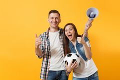 Young happy cheerful couple supporter, woman man, football fans cheer up support team, holding megaphone, soccer ball. Young happy cheerful couple supporter stock photos