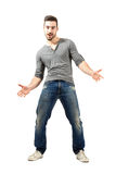 Young happy cheerful man with spread open arms Royalty Free Stock Photography