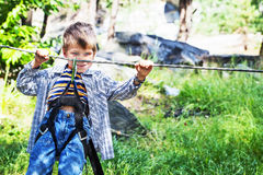 Young happy child boy in adventure park. Royalty Free Stock Images