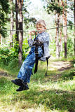 Young happy child boy in adventure park. Stock Photography