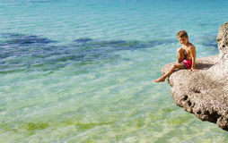 Young happy child boy on rocks on tropical sea backgroun Royalty Free Stock Image
