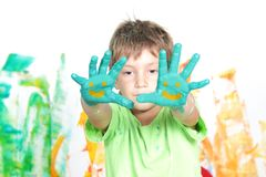 Young happy child boy with smiles on palms Stock Photo