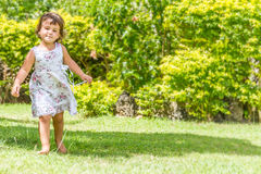 Young happy child girl running on outdoor natural back Royalty Free Stock Images