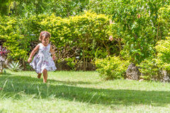 Young happy child girl running on outdoor natural back Stock Images