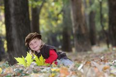 Young happy child on natural autumn backgrou Stock Images