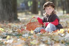 Young happy child on natural autumn backgrou Stock Image