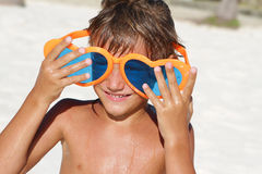 Young happy child playing on beach Stock Image