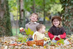Young happy children on natural autumn backgrou Royalty Free Stock Photography