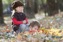 Young happy children on natural autumn backgrou Stock Image