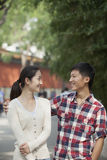 Young Happy Chinese Couple Walking In Jing Shan Park Royalty Free Stock Image