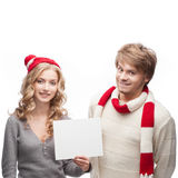 Young happy christmas couple holding sign Stock Photo