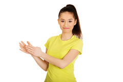 Young happy clapping woman. Royalty Free Stock Photos
