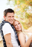 Young happy couple. Shallow DoF with focus on the woman Royalty Free Stock Image