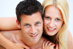 Young happy couple. Shallow DoF with focus on the man Royalty Free Stock Photos