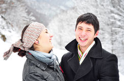Young happy couple. Smiling outdoors in winter background Royalty Free Stock Photography