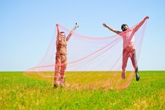 Young happy couple. On the field. Shoot on the nature Stock Photography