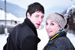 Young happy couple. Smiling outdoors in winter background Stock Photography