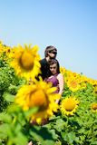 Young happy couple. On the field. Shoot on the nature Stock Photo