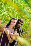 Young happy couple. On the field. Shoot on the nature Royalty Free Stock Image