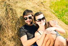 Young happy couple. On the field. Shoot on the nature Royalty Free Stock Photo