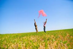 Young happy couple. On the field. Shoot on the nature Stock Photos