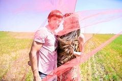 Young happy couple. On the field. Shoot on the nature Royalty Free Stock Photos