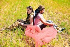 Young happy couple. On the field. Shoot on the nature Royalty Free Stock Photography