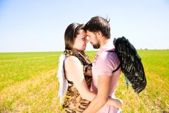 Young happy couple. On the field. Shoot on the nature Stock Image