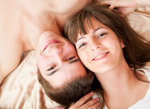 Young happy couple. In bed Royalty Free Stock Images