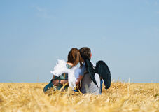 Young happy couple. On the field. Shoot on the nature Stock Images