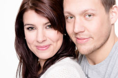 Young and happy couple. In front of white background Royalty Free Stock Photography