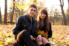 Young happy couple in autumn park Stock Photos
