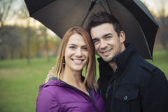 Young happy couple in autumn season Royalty Free Stock Image