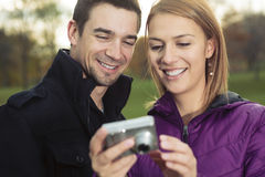 Young happy couple in autumn season Royalty Free Stock Photos