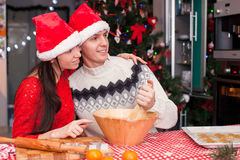 Young happy couple baking Christmas cakes Royalty Free Stock Photos