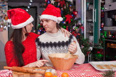 Young happy couple baking Christmas cakes Stock Photography
