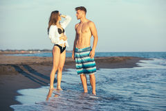 Young happy  couple  on beach Royalty Free Stock Photos