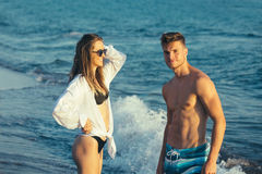 Young happy  couple  on beach Royalty Free Stock Photography